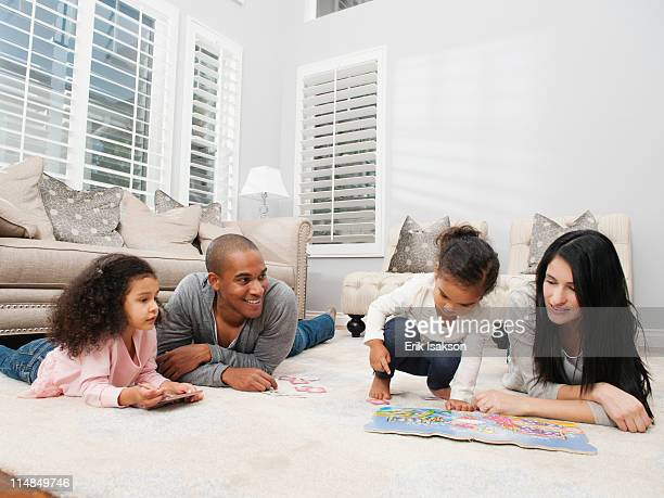 family relaxing on living room floor - mom flirting 個照片及圖片檔