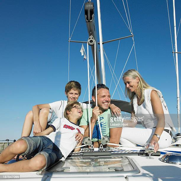 Family relaxing on sailboat