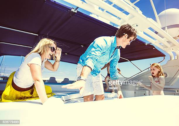 Family relaxing on yacht for holidays