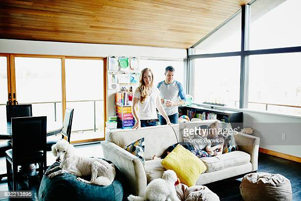 Family relaxing together in living room of home