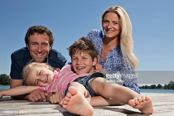 Family relaxing together on dock