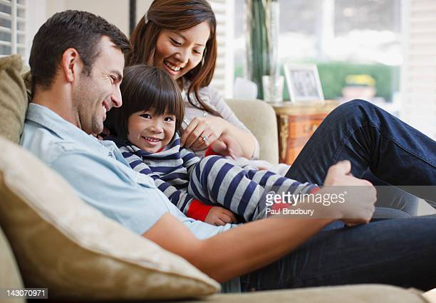 Family relaxing together on sofa