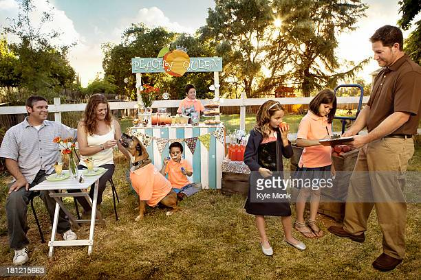 family relaxing together outdoors - dog eats out girl stock pictures, royalty-free photos & images