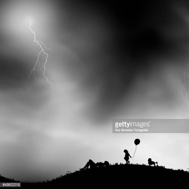 Family relaxing watching a storm