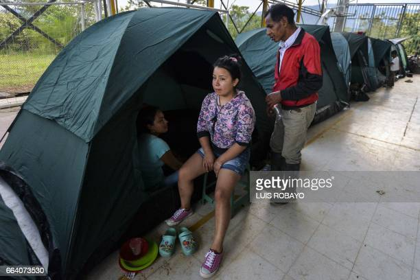 A family remains at a shelter in Mocoa Putumayo department southern Colombia on April 3 2017 Residents of Mocoa were Monday desperately searching for...