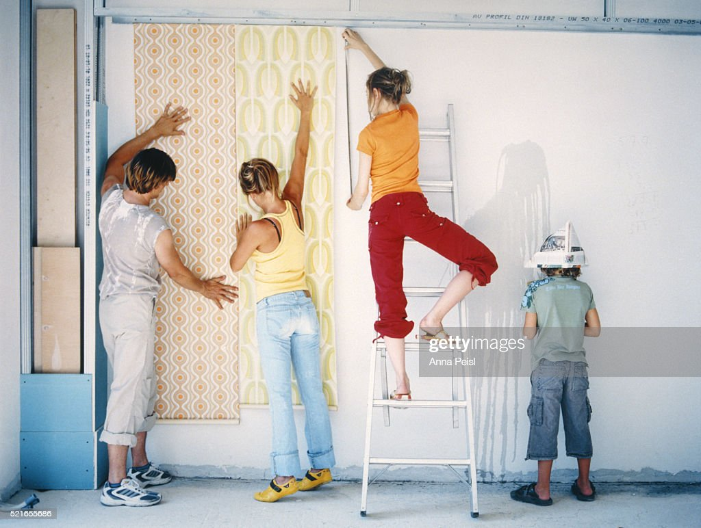 Family Renovating Home : Stock Photo
