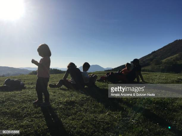Family resting after mountain hiking. Tolosa, Basque Country