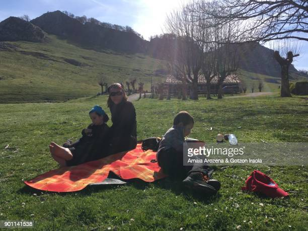 Family resting after mountain hiking. Urbia, Basque Country