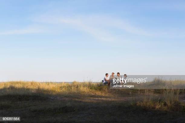 Family resting at seaside