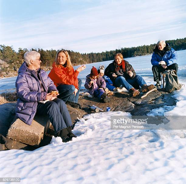 Family resting during winter trip