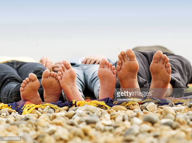 family resting on beach - pretty white girl feet stock photos and pictures