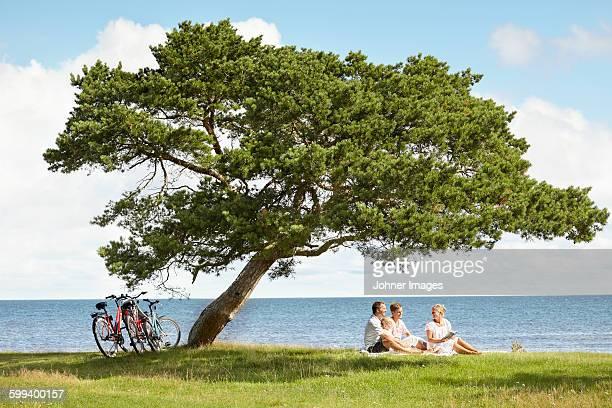 Family resting under tree
