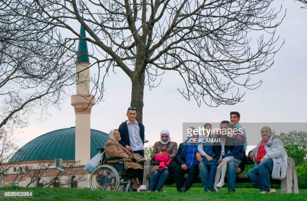 A family rests and sings near a mosque of the Islam Centre of Vienna on April 14 2017 in Vienna Austria A debate is raging in Austria after a study...