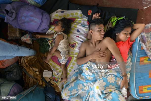 TOPSHOT A family rests at a shelter in Mocoa Putumayo department southern Colombia on April 3 2017 Residents of Mocoa were Monday desperately...
