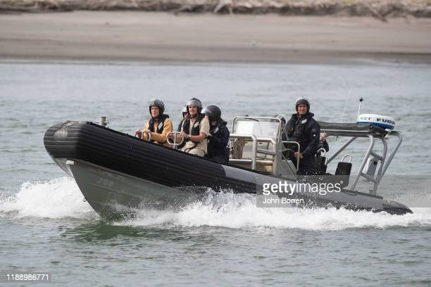 Family return from the Frigate HMNZS Wellington where they observed a minutes silence near White Island on December 16 2019 in Whakatane New Zealand...
