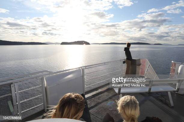 family ride ferry on ocean crossing, at sunrise - ferry stock pictures, royalty-free photos & images