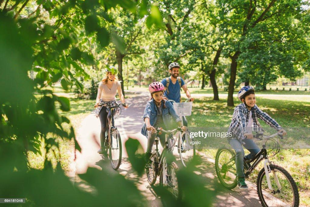 Family riding bicycle : Stock Photo
