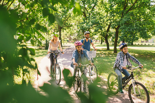 Family riding bicycle 694181048