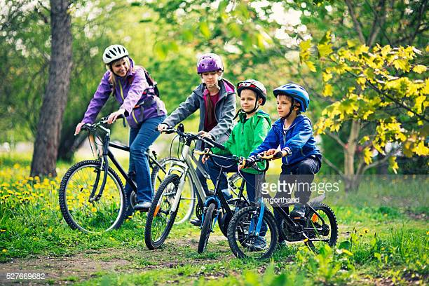 Family riding bicycles in beautiful nature
