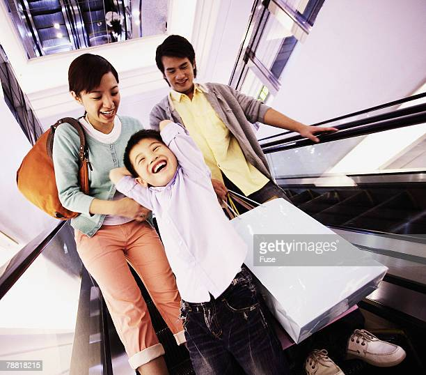 Family Riding Escalator
