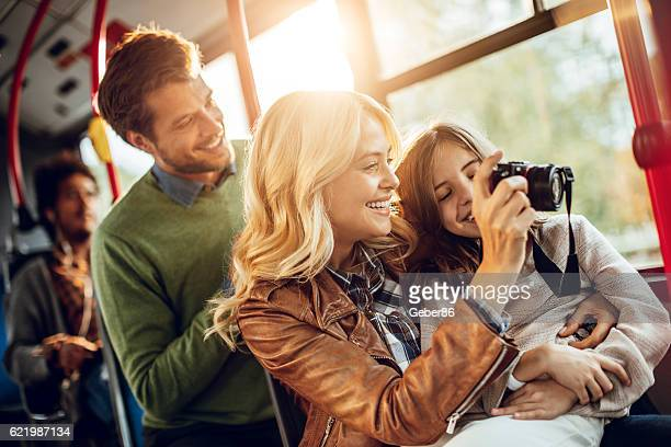 family riding in a bus - pointing at camera stock photos and pictures