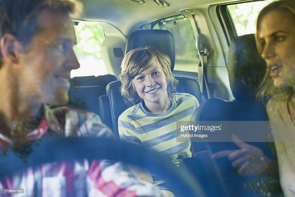 Family riding in car together : Stock Photo