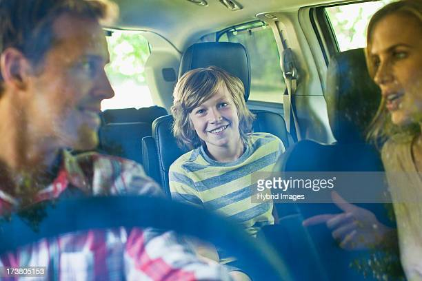 family riding in car together - family inside car stock photos and pictures