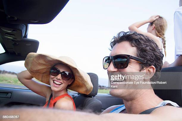 Family riding in convertible