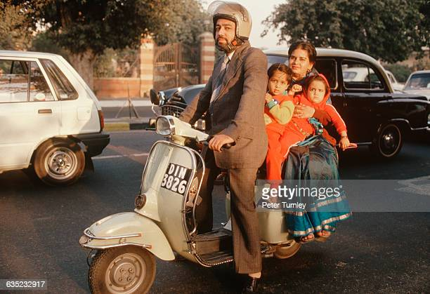 A Family Riding on a Scooter