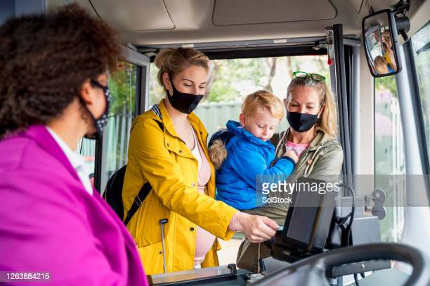 family riding the bus - public transport stock pictures, royalty-free photos & images