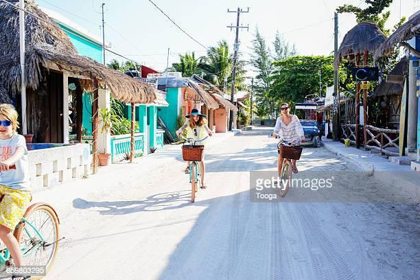 Family riding through small Mexican beach town
