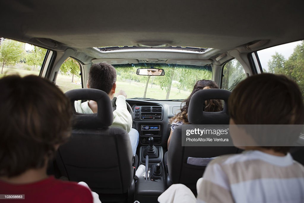 Family riding together in car : Stock Photo