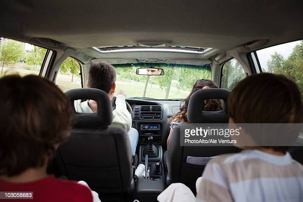 family riding together in car - family inside car stock photos and pictures
