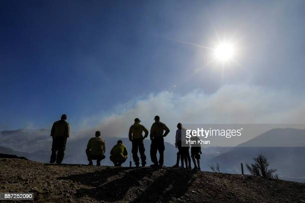 A family right who lives deep down in Indian Spring Ranch and ShastaTrinity National Forest crew on a hilltop observe fire activity along Little...