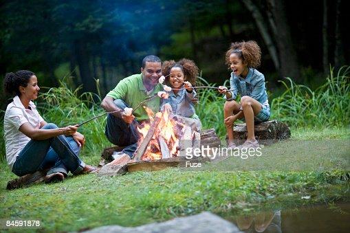 Family Roasting Marshmallows Over A Campfire Stock Photo ...