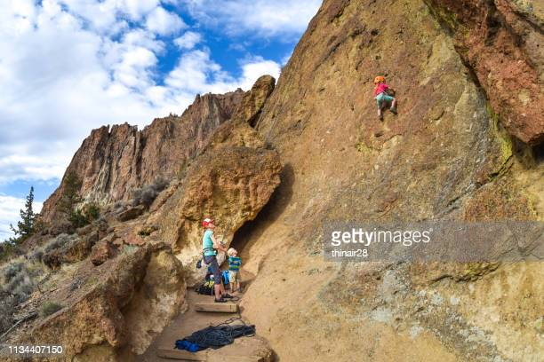 family rock climbing - smith rock state park stock pictures, royalty-free photos & images