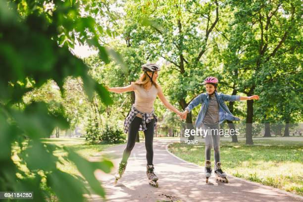 family roller skating - inline skate stock photos and pictures