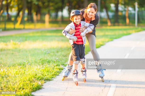 family rollerblading in a park - inline skating stock pictures, royalty-free photos & images