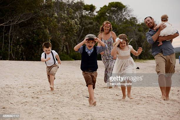 Family running along beach