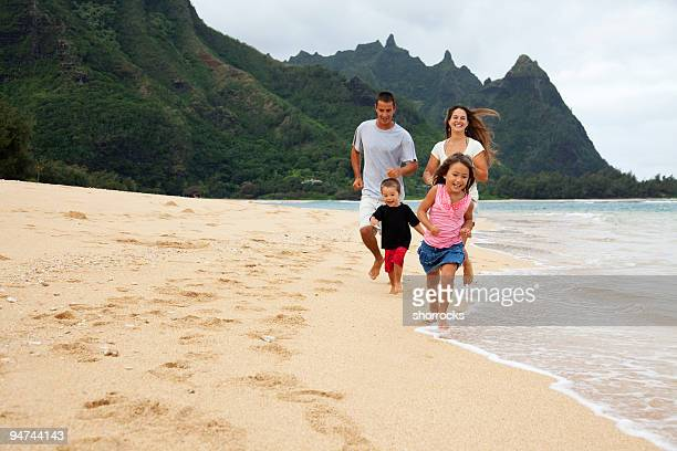 Family Running at Beach