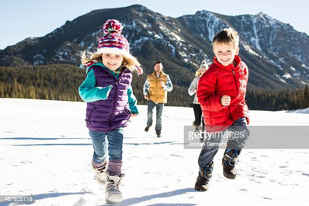 Family running in the snow.