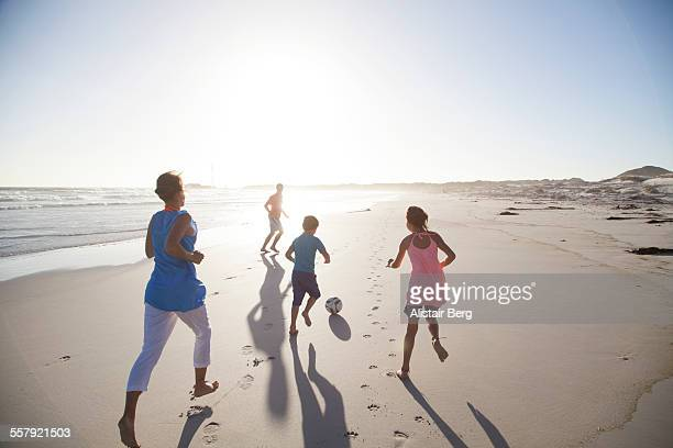 Family running on beach together