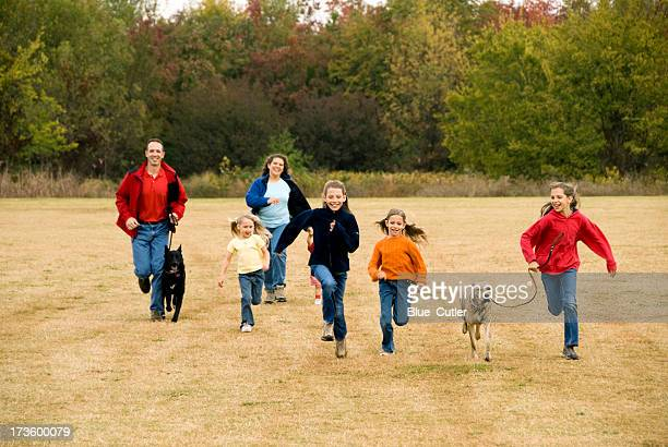 family running - large family stock photos and pictures