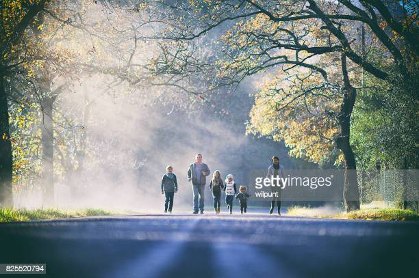 Family running together between trees
