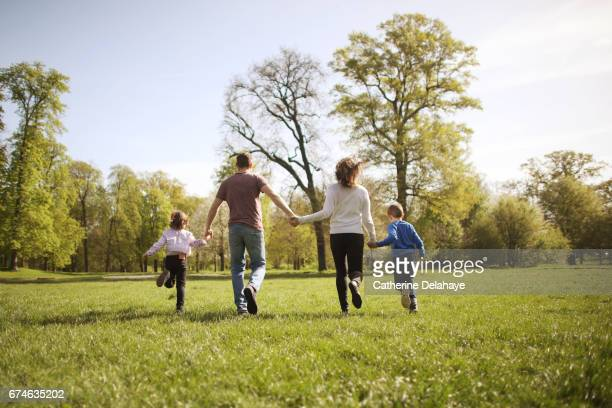 A family running together in a park