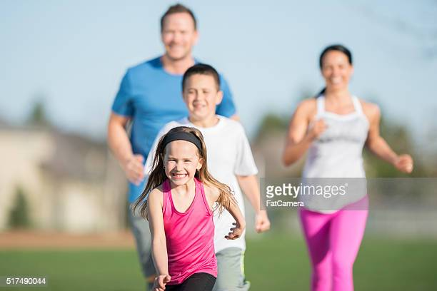Family Running Together in the Park