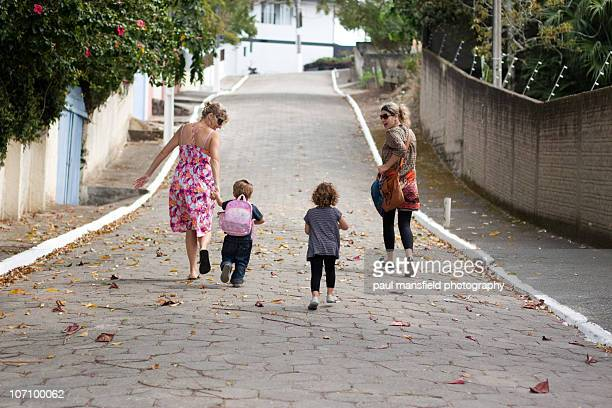 Family running up an empty street