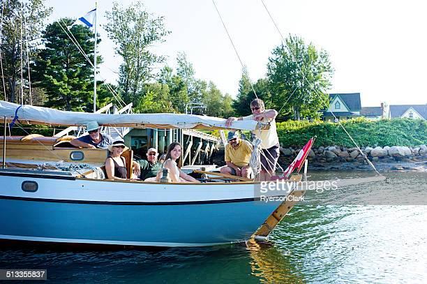 family sailing on mahone bay nova scotia - flag of nova scotia stock pictures, royalty-free photos & images