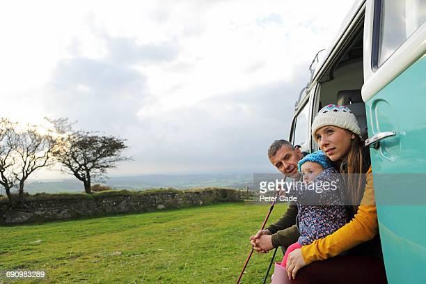 Family sat in camper van on moors