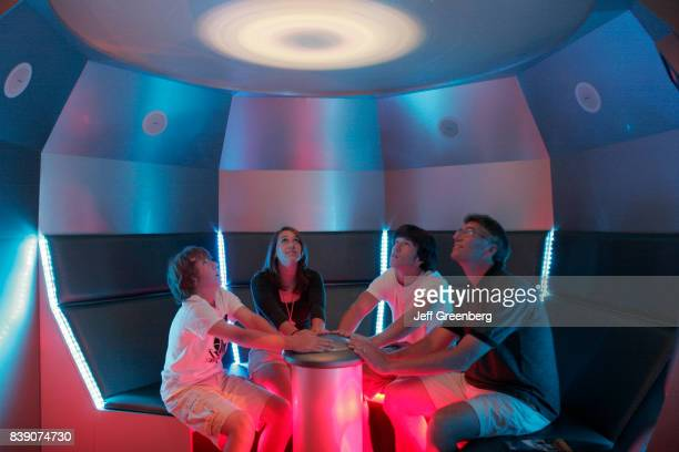 A family sat in the Time Machine exhibit at Virginia Air and Space Center